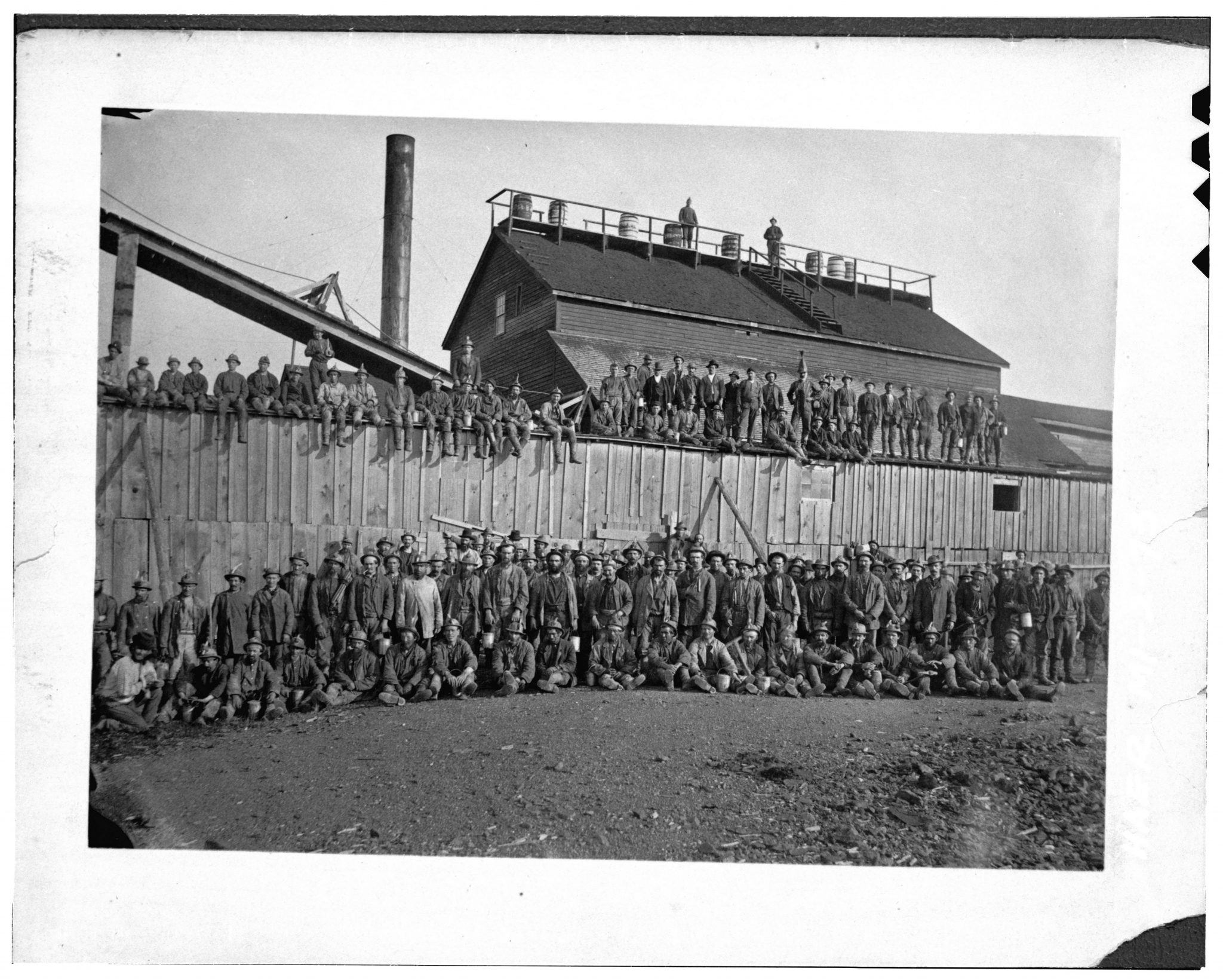<br /> 1875 QMC workforce assembled behind hoist house HAER MICH.