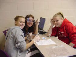 three students working on a lab assignment in a team