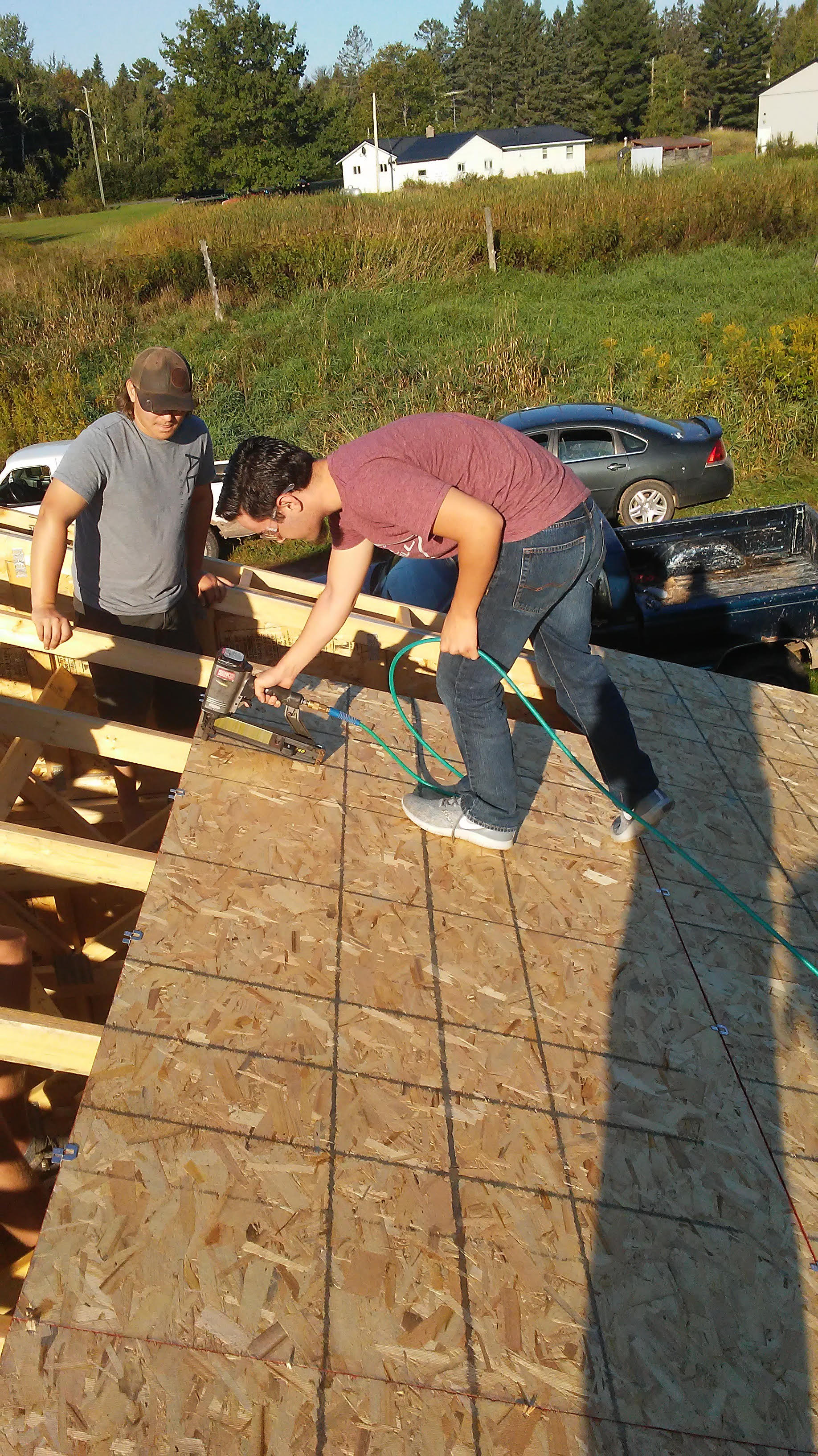Roofing panel installation with pneumatic nail gun