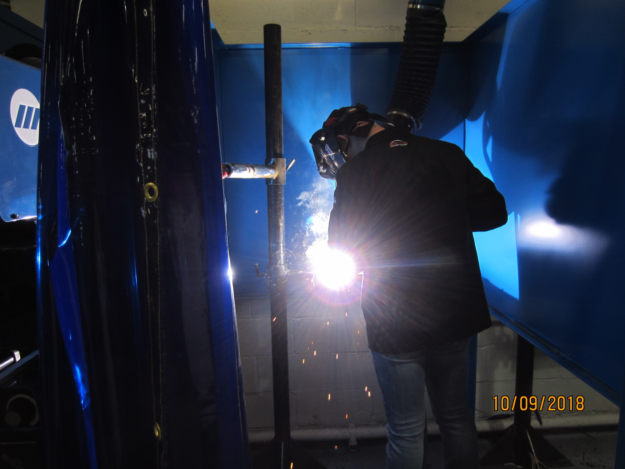 welding behind protective screens