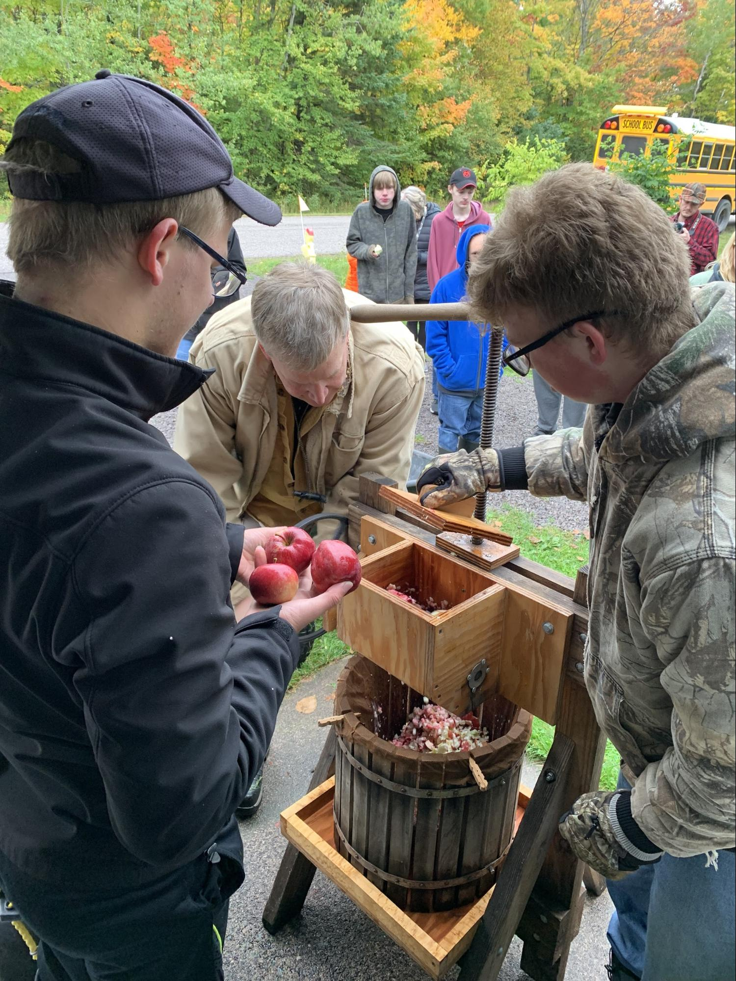 Students pressing apples at the Gierke Blueberry Farm